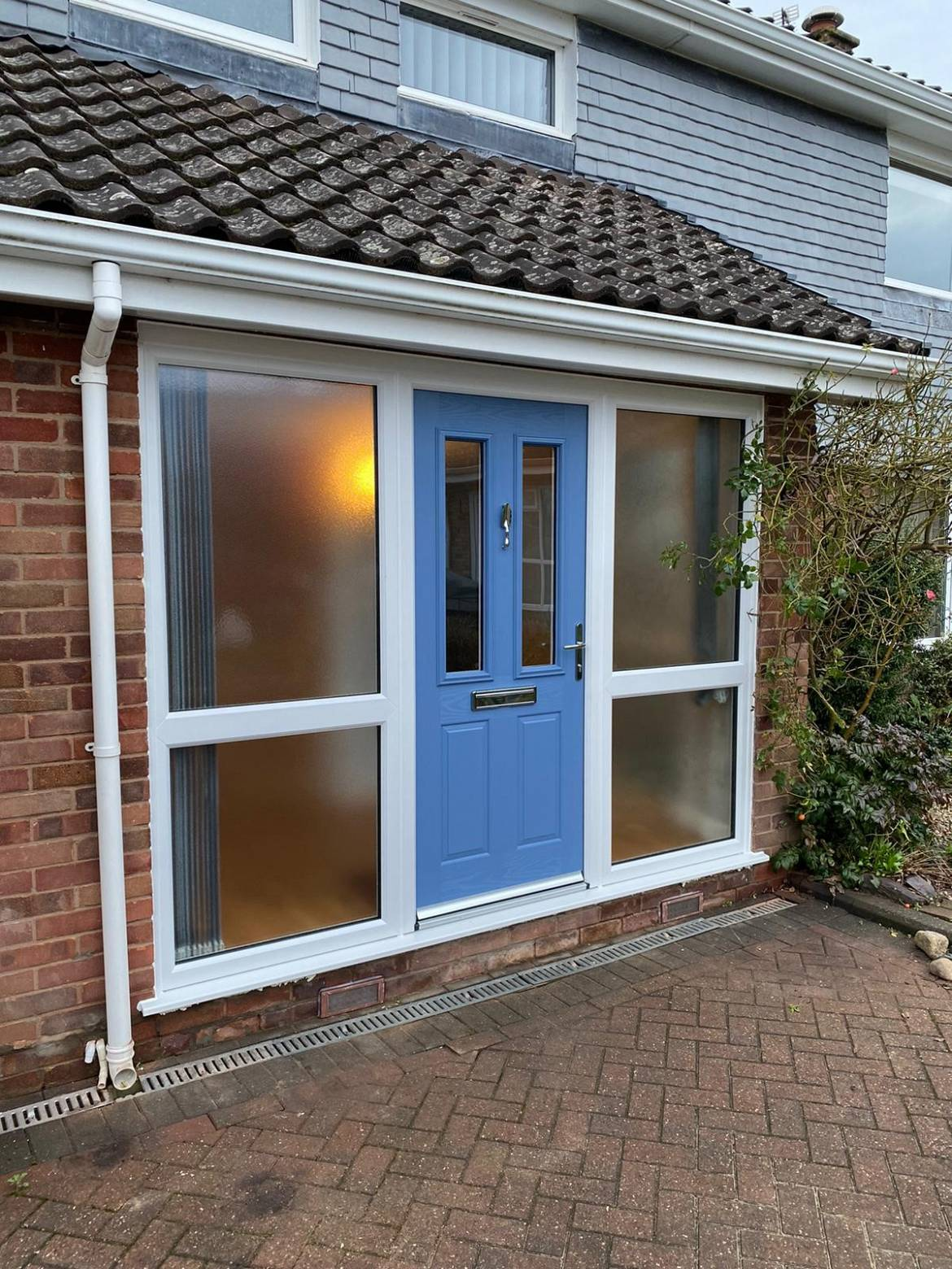 aaa upvc entrance after with new composite door and side screens